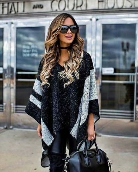black knitted poncho with wide, wide stripes