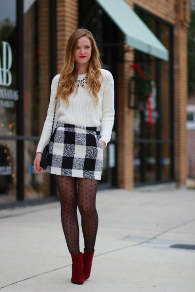 black knitted sweater and black patterned stockings