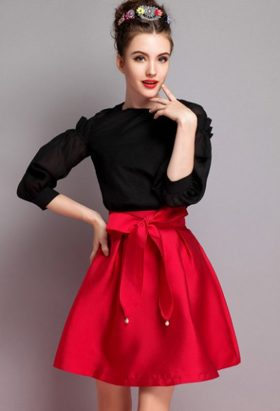 black knitted sweater, red knotted flared skirt