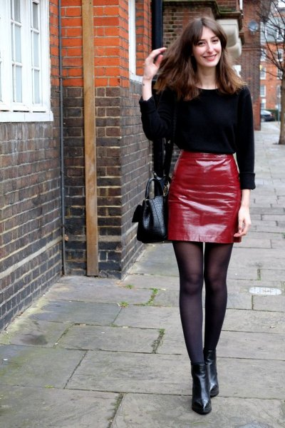 black knitted sweater, red leather mini skirt