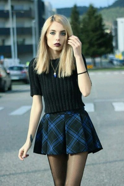 black knitted sweater with checked mini flake skirt