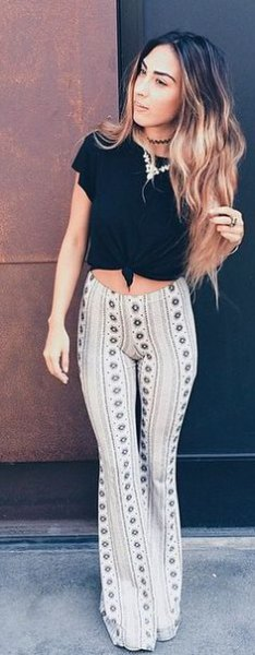 black knotted t-shirt with white tribal printed yoga pants with bell bottom