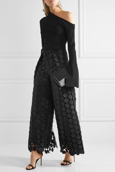 black lace trousers over the top with one shoulder