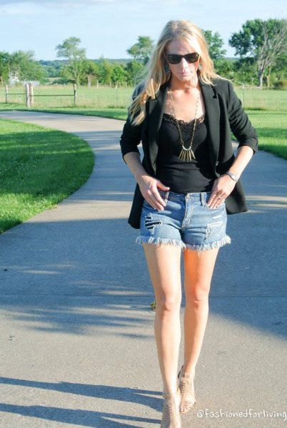 black lace vest top with blazer and mini denim shorts