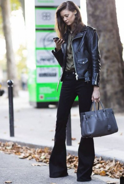 black leather biker jacket with a burgundy shirt and flared jeans