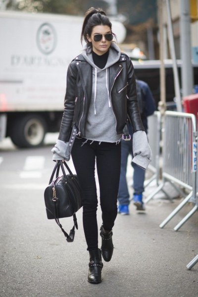 black leather biker jacket with gray hoodie and moto boots