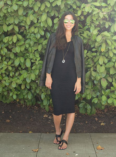 black leather biker jacket with midi dress and sandals