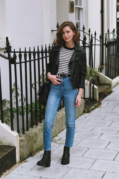 black leather blazer with striped t-shirt and blue jeans