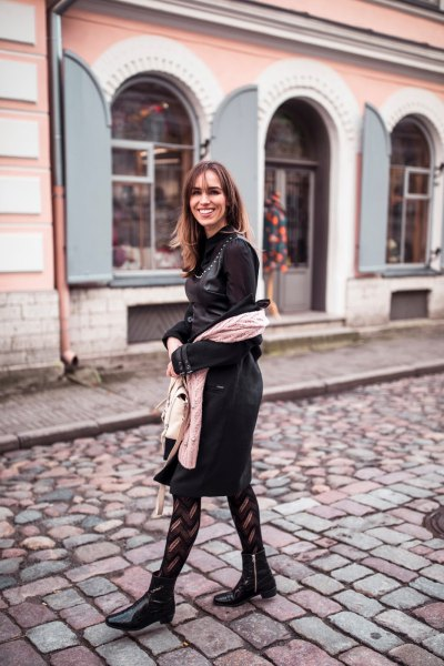 black leather dress with ankle boots and striped tights