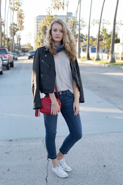 black leather jacket over striped t-shirt
