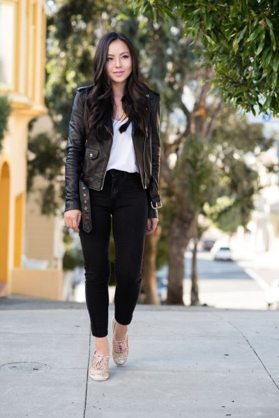 black leather jacket with ankle jeans and white blouse with scoop neckline