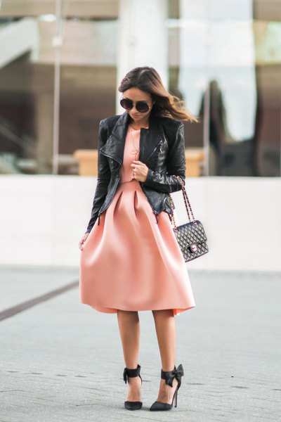 black leather jacket with blushing pink fit and flared midi dress