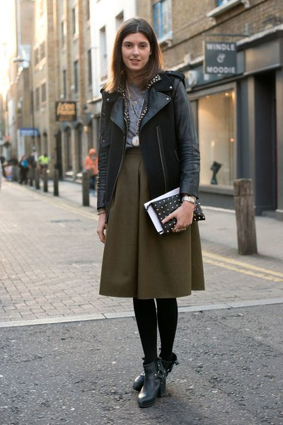 black leather jacket with burgundy midi skater skirt with a high waist