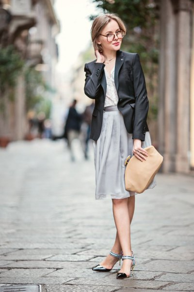 black leather jacket with a chiffon gray skirt and a blushing wallet