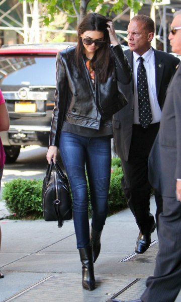 black leather jacket with dark blue moto jeans and boots