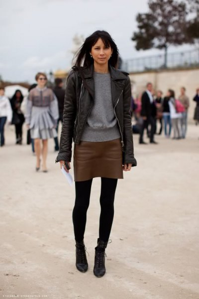 black leather jacket with dark leather mini skirt