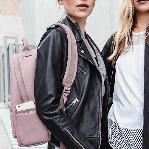 black leather jacket with gray backpack wallet
