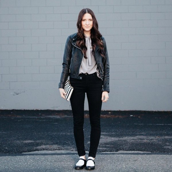 black leather jacket with gray blouse and flats