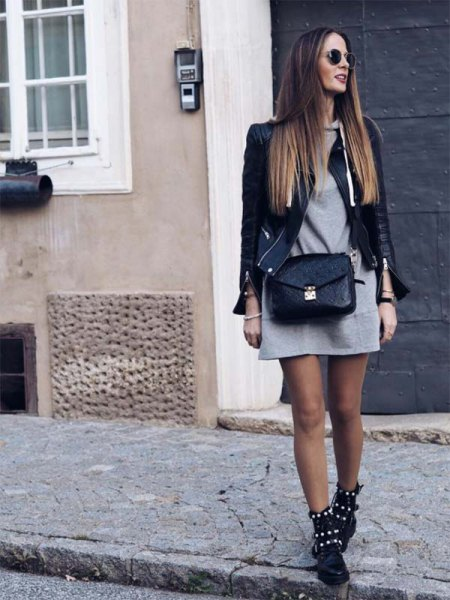 black leather jacket with gray mini hoodie dress and studded combat boots