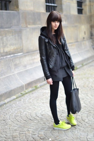 black leather jacket with gray mini skirt and yellow sneakers