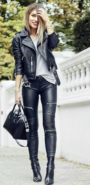 black leather jacket with gray, oversized t-shirt and moto leggings