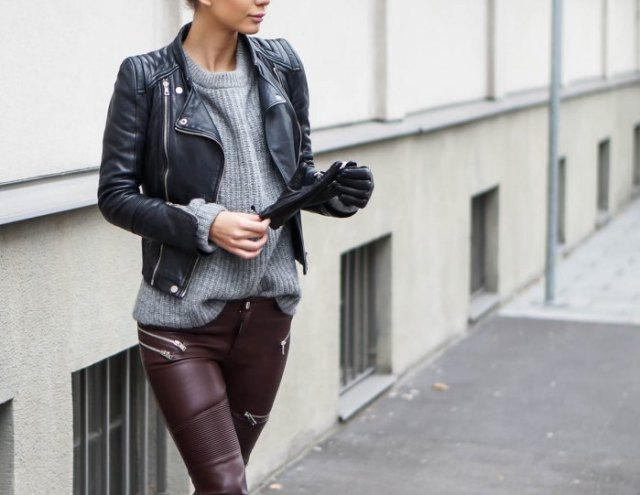 black leather jacket with gray ribbed sweater and moto pants