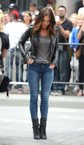 black leather jacket with gray t-shirt and black skinny jeans