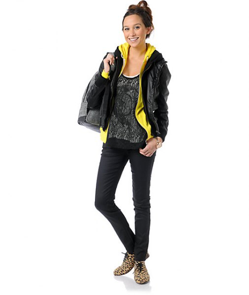 black leather jacket with lemon yellow hoodie and top with scoop neck