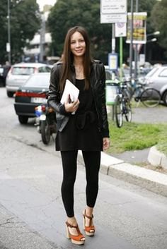 black leather jacket with mini sheath dress and footless tights