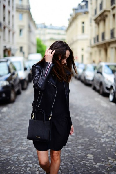 black leather jacket with mini shift dress and wallet