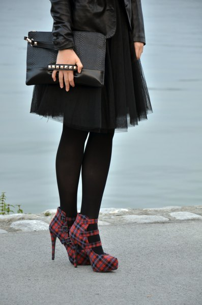black leather jacket with mini tulle skirt and red checked heels