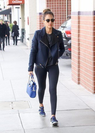 black leather jacket with dark blue leggings and blue sneakers