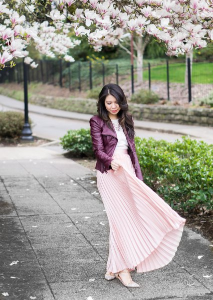 black leather jacket with light pink maxi pleated skirt