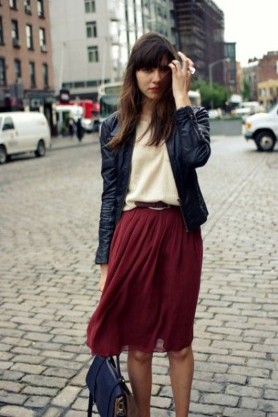 black leather jacket with light yellow sweater and burgundy chiffon midi skirt