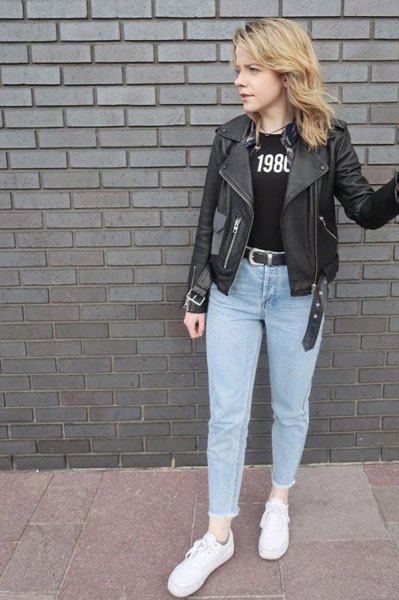 black leather jacket with print T-shirt and light blue mom jeans