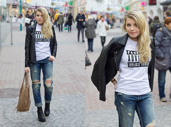black leather jacket with printed t-shirt and ripped jeans