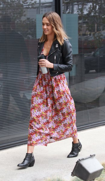 black leather jacket with red and blue chiffon maxi dress with floral pattern