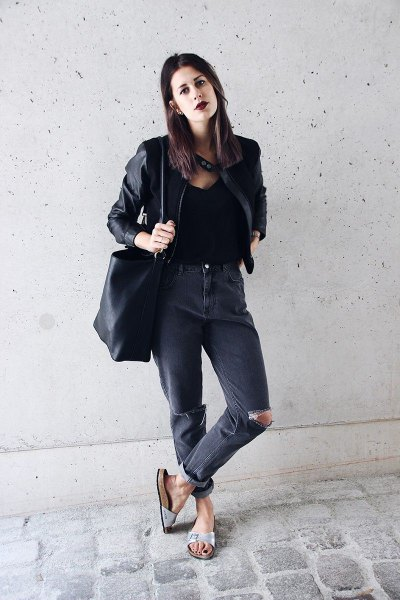 black leather jacket with ripped jeans and slide sandals