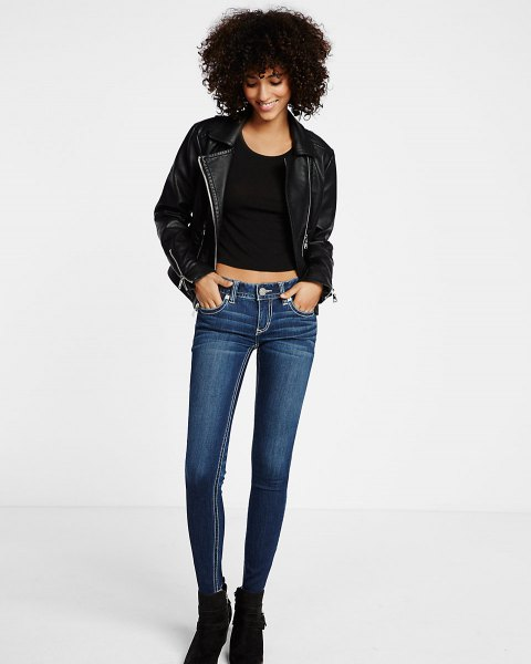black leather jacket with crop top with scoop neckline and dark blue skinny jeans