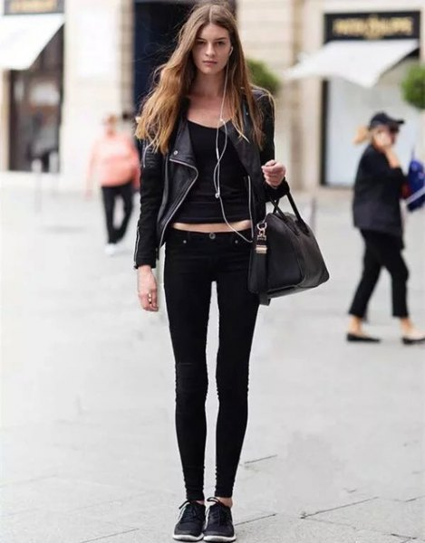 black leather jacket with crop top with scoop neckline and skinny jeans