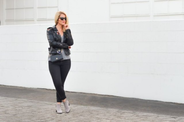 black leather jacket with t-shirt with scoop neckline and gray ankle boots