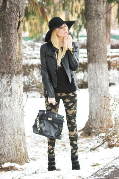 black leather jacket with skinny jeans and floppy hat