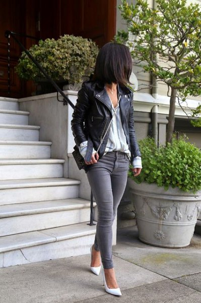 black leather jacket with striped shirt and gray skinny jeans