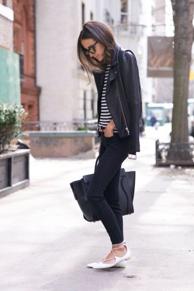 black leather jacket with striped t-shirt and white, pointed straps