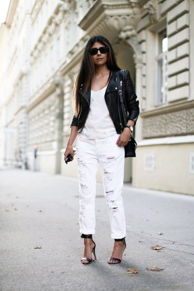 black leather jacket with tank top and white boyfriend jeans