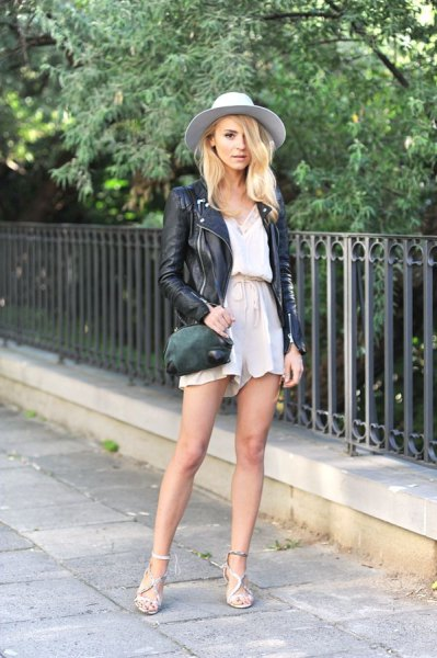 black leather jacket with white blouse and blushing flowing shorts