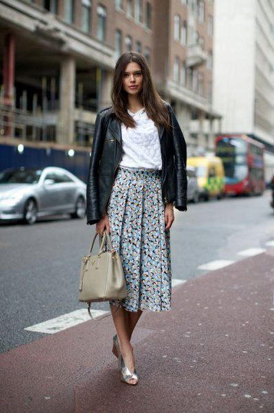 black leather jacket with white blouse and pleated skirt with floral pattern
