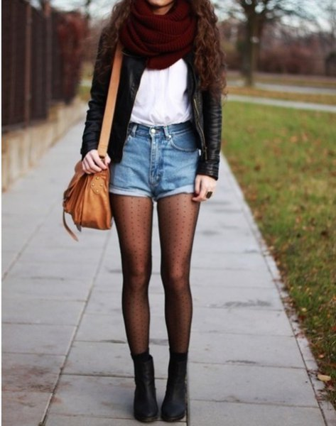 black leather jacket with white chiffon top and brown leather shoulder bag