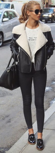 black leather jacket with white collar and skinny jeans