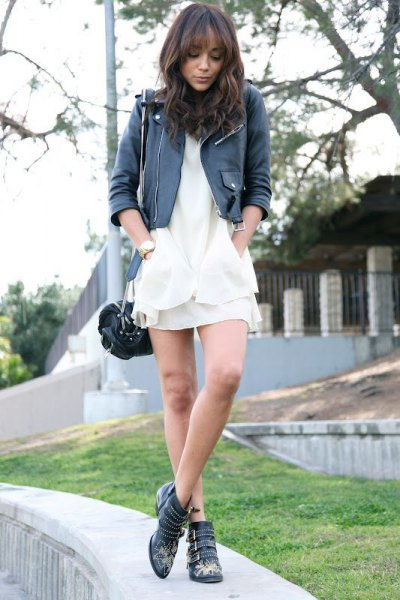 black leather jacket with white mini dress and leather boots